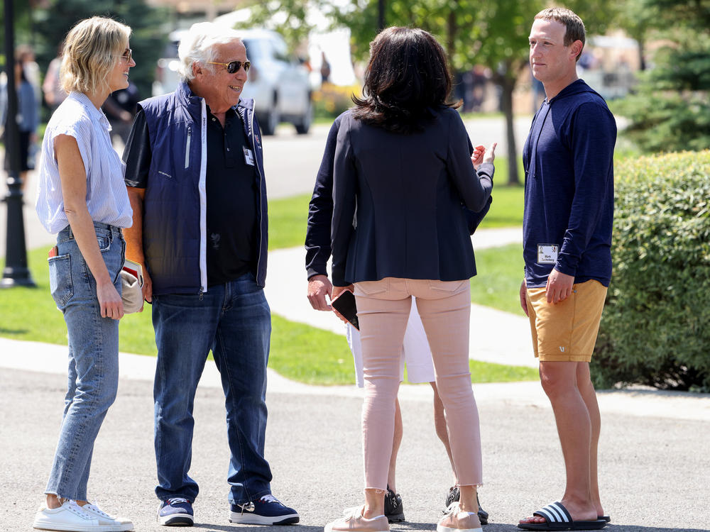 From left to right, Dana Blumberg stands next to her boyfriend, New England Patriots owner Robert Kraft, Facebook COO Sheryl Sandberg and Facebook CEO Mark Zuckerberg as they talk after a session at the Allen & Company Sun Valley Conference on Thursday in Sun Valley, Idaho. Top execs across media, tech and sports gathered for their annual event known as
