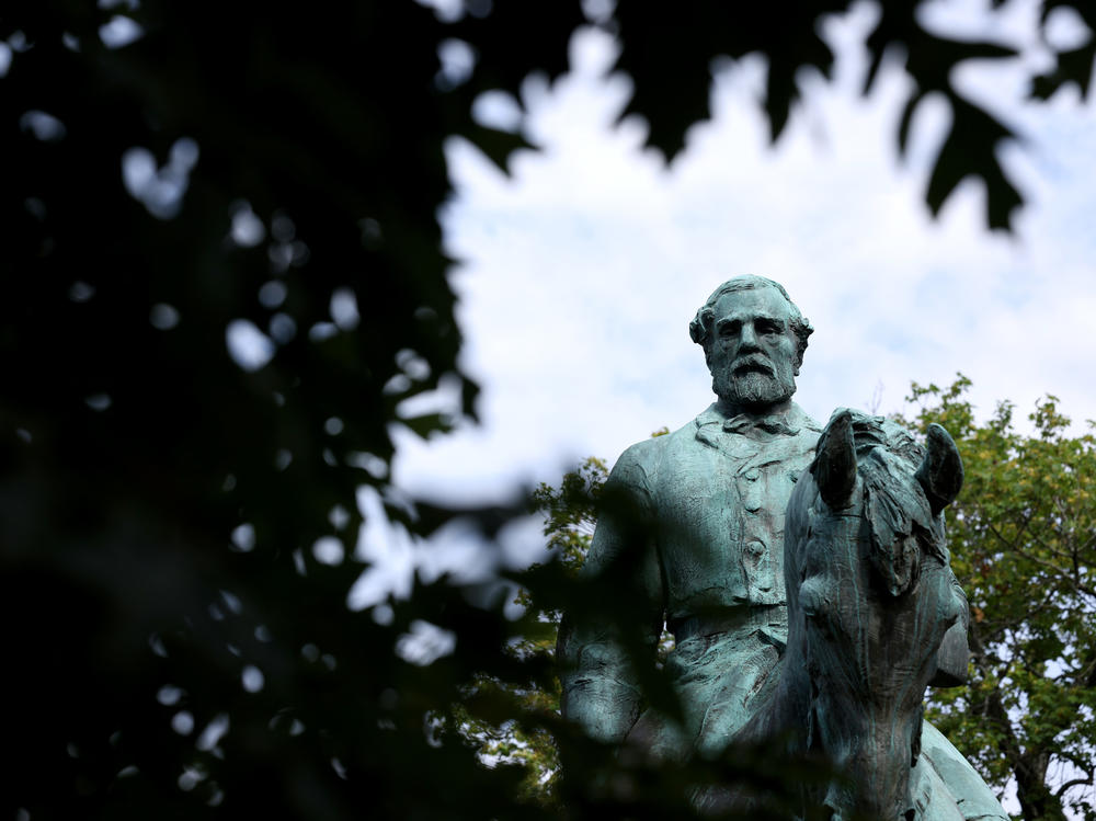 A statue of Confederate Gen. Robert E. Lee is shown in Market Street Park July 9, 2021 in Charlottesville, Va. The statute, along with another of Gen. Stonewall Jackson, will be removed Saturday.