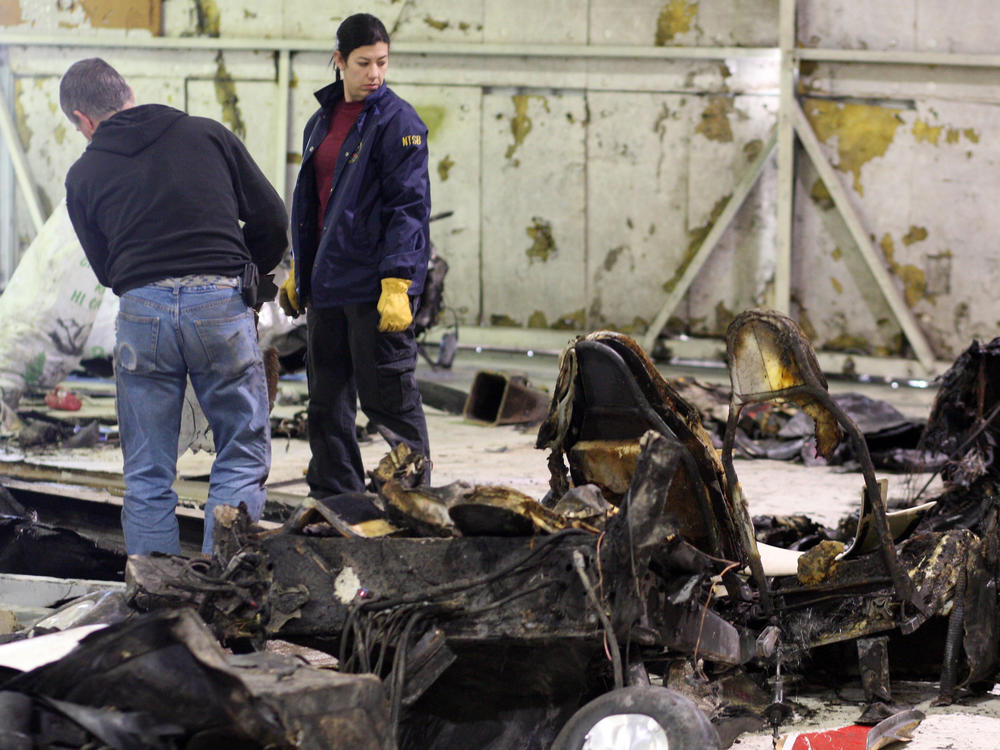 Inspectors examine of the wreckage of a Lancair experimental aircraft that crashed in February 2012, killing Micron CEO Steve Appleton.
