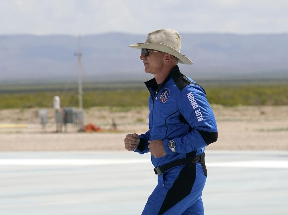 Jeff Bezos, founder of Amazon and space tourism company Blue Origin, jogs onto his rocket landing pad ahead of his trip to the edge of space on Tuesday. When top executives like Bezos have dangerous hobbies, there's often little company boards can do.