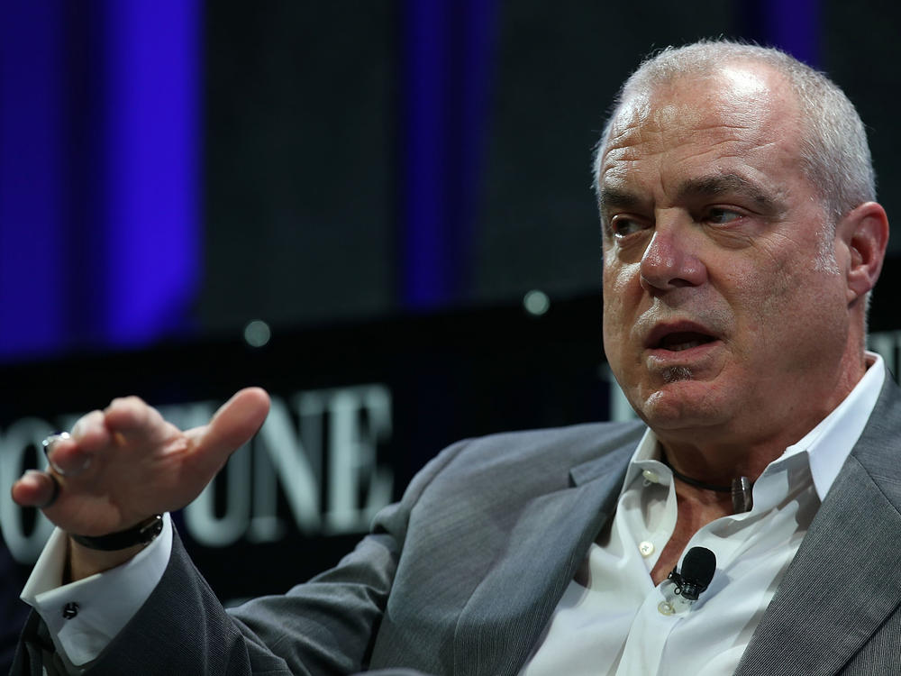 Former Aetna chairman and CEO Mark Bertolini speaks at conference in San Francisco in 2015. Bertolini is an avid motorcyclist and skier, and he fended off Aetna's efforts to limit him from those hobbies.