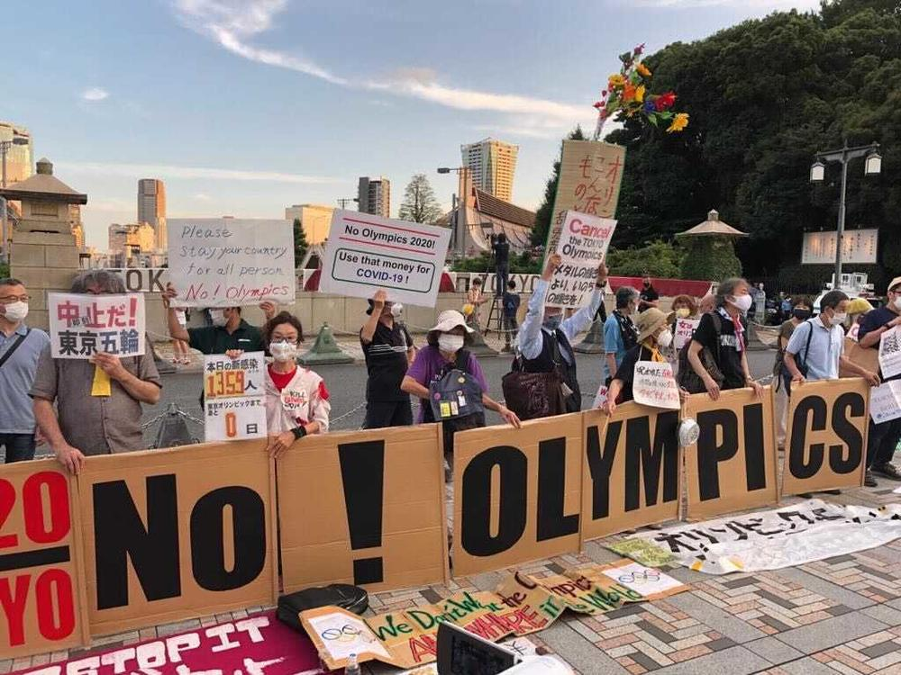 Demonstrators gather in Tokyo on Friday to protest the start of the Olympic Games.