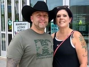 Randy Rathbun and Sophia Heid pose in front of the Clark County Marriage License Bureau in downtown Las Vegas. They plan to hold their wedding ceremony in a helicopter flying over the city.