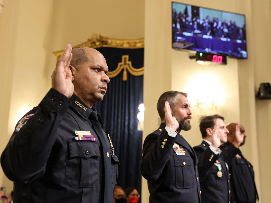 U.S. Capitol Police Sgt. Aquilino Gonell (from left), officers Michael Fanone and Daniel Hodges of the Washington, D.C., Metropolitan Police Department, and Capitol Police Pfc. Harry Dunn are sworn in Tuesday before testifying before the House select committee investigating the Jan. 6 attack.