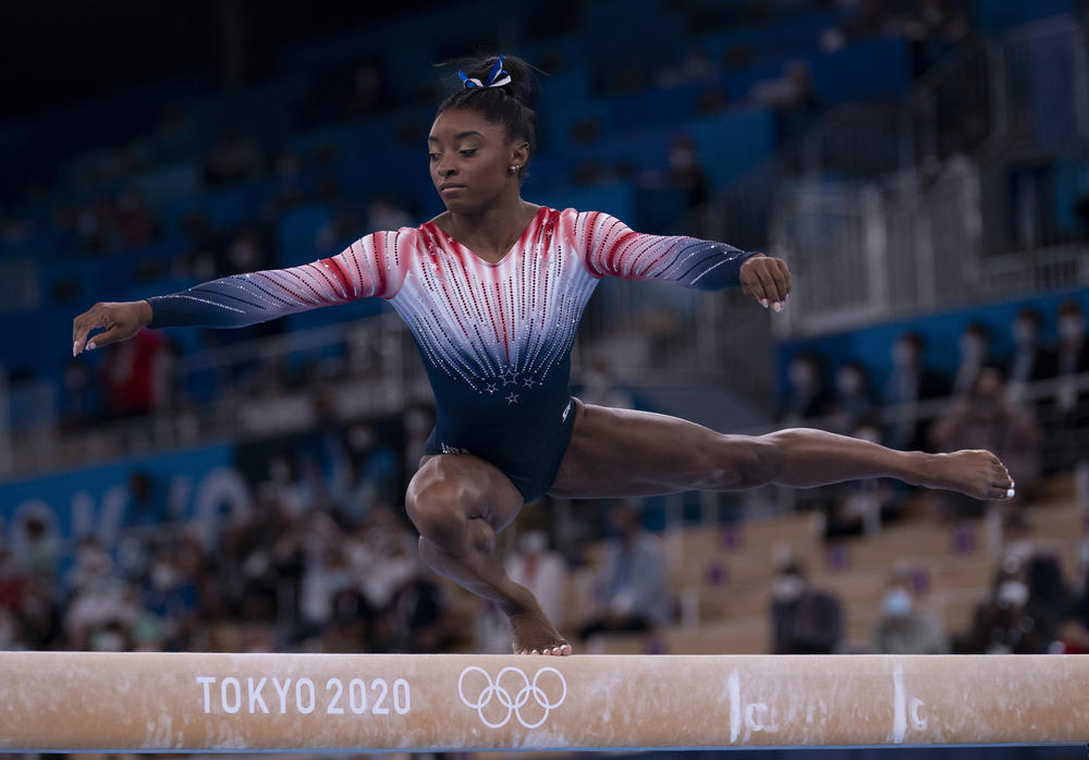 Simone Biles competes in the balance beam final on August 3.