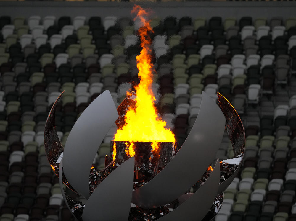 The Olympic flame burns prior to the Closing Ceremony in the Olympic Stadium at the Summer Olympics on Sunday in Tokyo.