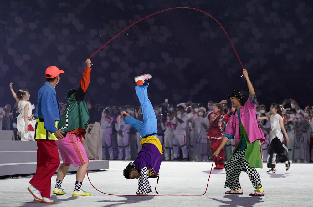 Dancers perform during the closing ceremony in the Olympic Stadium.