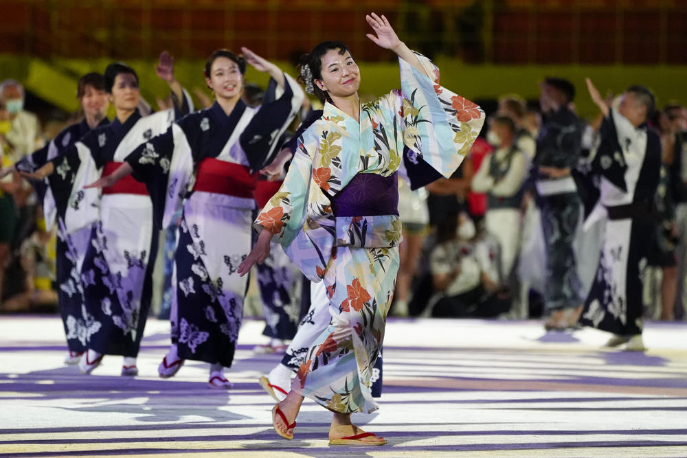 Artists perform during the closing ceremony in the Olympic Stadium at the Summer Olympics in Tokyo.