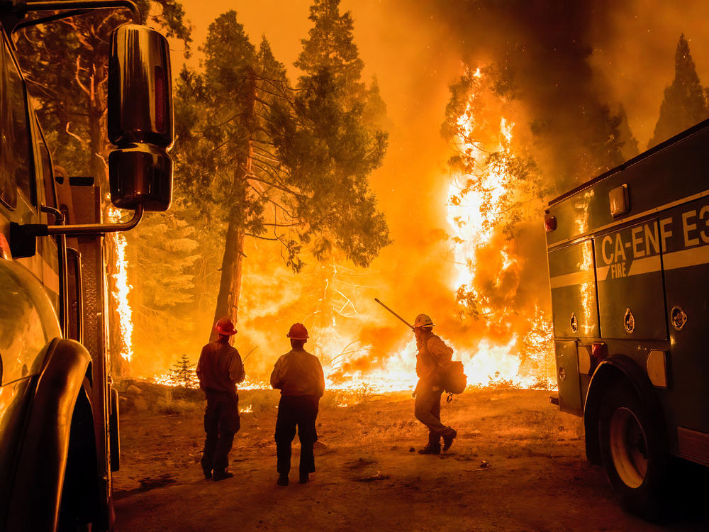 Crews set a backfire in an effort to gain control of the massive Caldor fire near the Tahoe basin in California on Aug. 26.