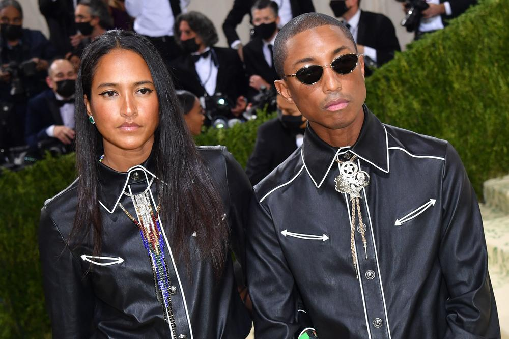 Helen Lasichanh and American musician and producer Pharrell Williams in a cowboy inspired outfit by Channel.