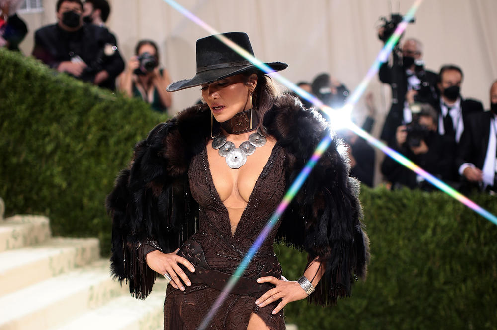 Jennifer Lopez wears a David Koma dress with a cowboy hat.