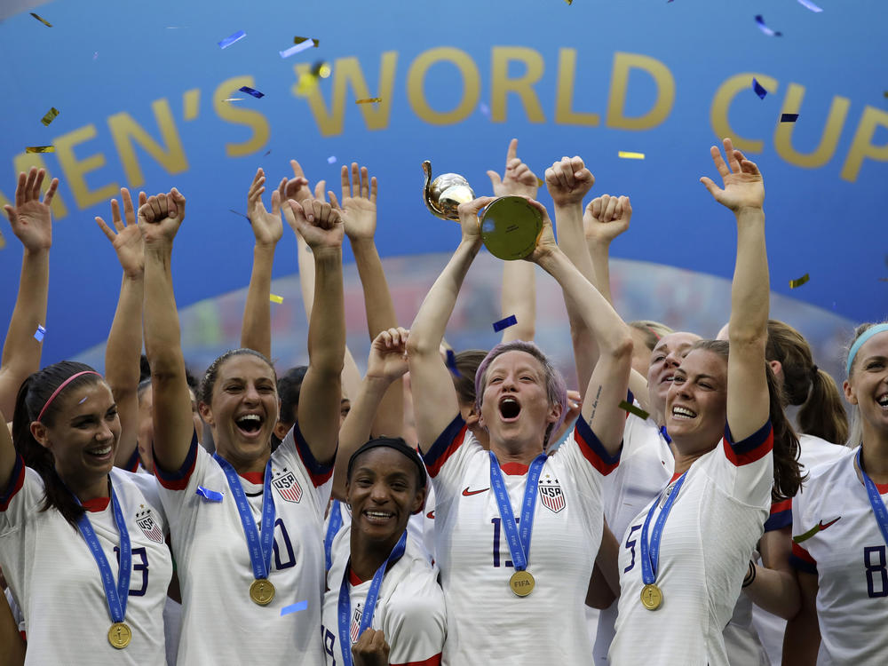 U.S. soccer player Megan Rapinoe raises the trophy in 2019 after winning the Women's World Cup final between the U.S. and The Netherlands in Decines, outside Lyon, France.