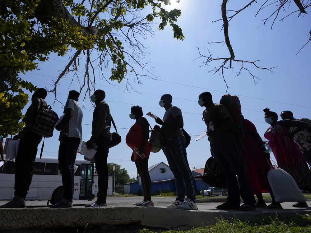 Migrants stand in line at a respite center in June after they crossed the U.S.-Mexico border and turned themselves in and were released in Del Rio, Texas.