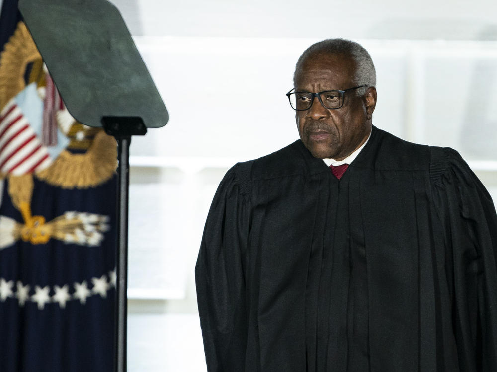 U.S. Supreme Court Justice Clarence Thomas listens during a ceremony on the South Lawn of the White House in Washington, D.C., on Oct. 26, 2020.