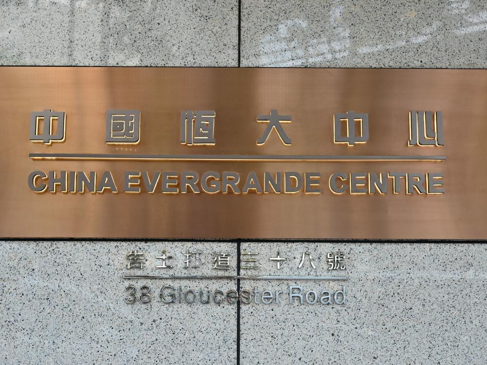 A sign for the China Evergrande Centre, the Hong Kong home for China Evergrande Group, is shown last week. Fears of a debt default at the property developer sparked a global stock market sell-off on Monday.
