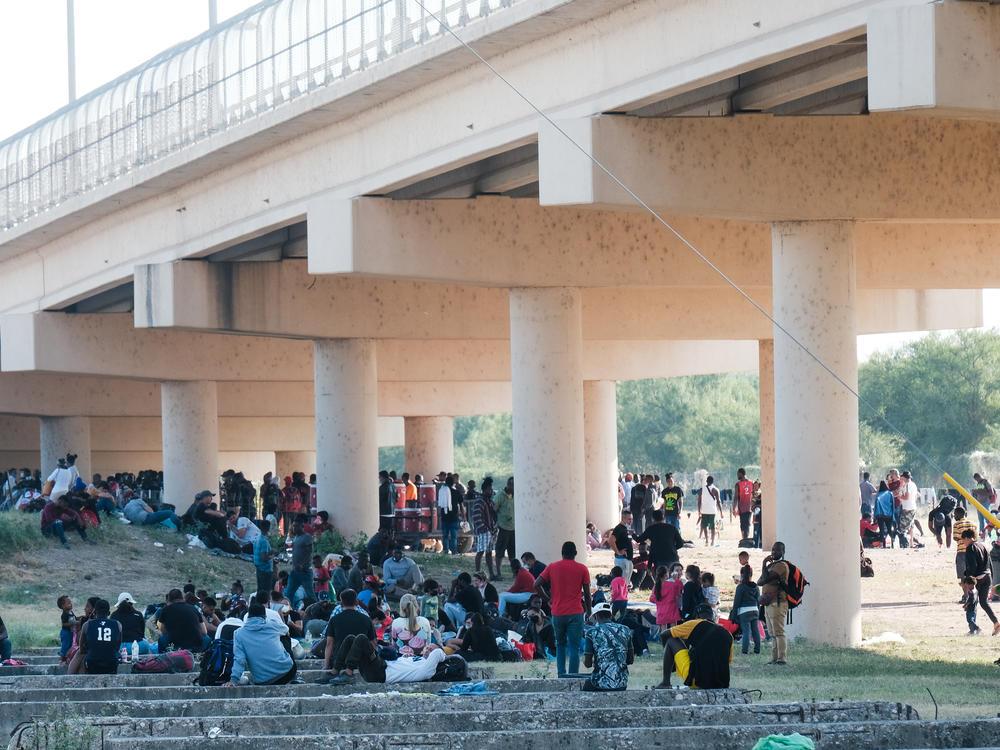 Migrants at the Rio Grande near the port of entry in Del Rio, Texas, on Saturday.