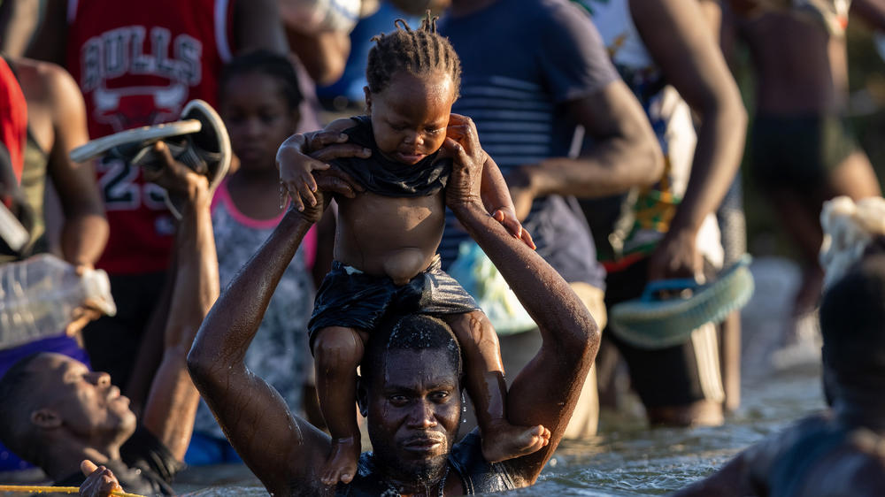 Haitians cross the Rio Grande back into Mexico from Del Rio on Monday. As U.S. authorities began deporting migrants back to Haiti, thousands more waited in a camp in Del Rio and others crossed the river back into Mexico to avoid deportation.