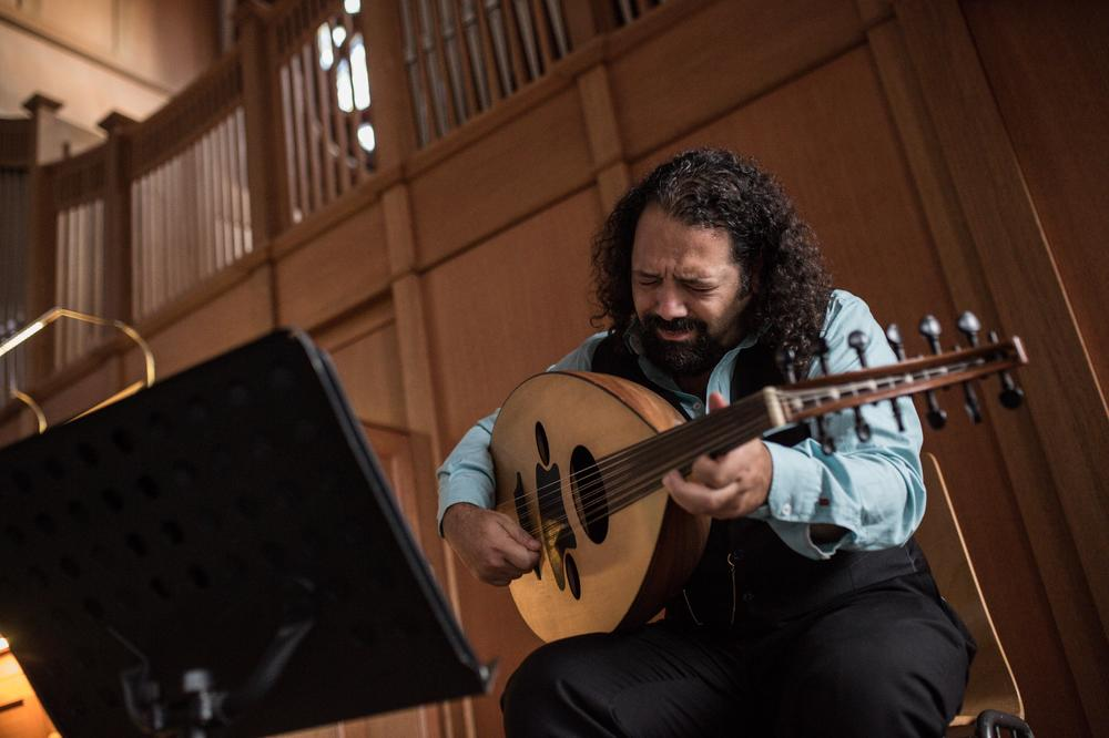 Wassim Mukdad plays the oud in Berlin. He says he never told his interrogators or anyone in prison in Syria he was a musician for fear they would hurt his hands.