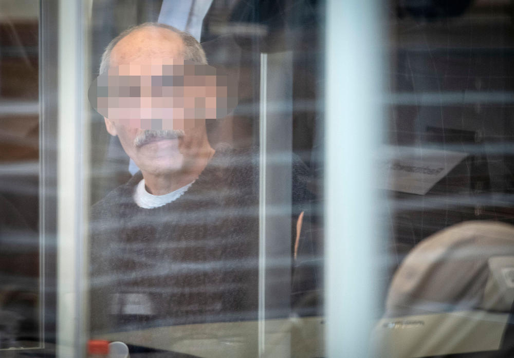 Syrian defendant Anwar Raslan arrives in court in Koblenz, Germany, on April 23, 2020. German prosecutors accuse him of crimes against humanity and other crimes for overseeing systematic torture and abuse of more than 4,000 prisoners, which prosecutors say led to 58 deaths.