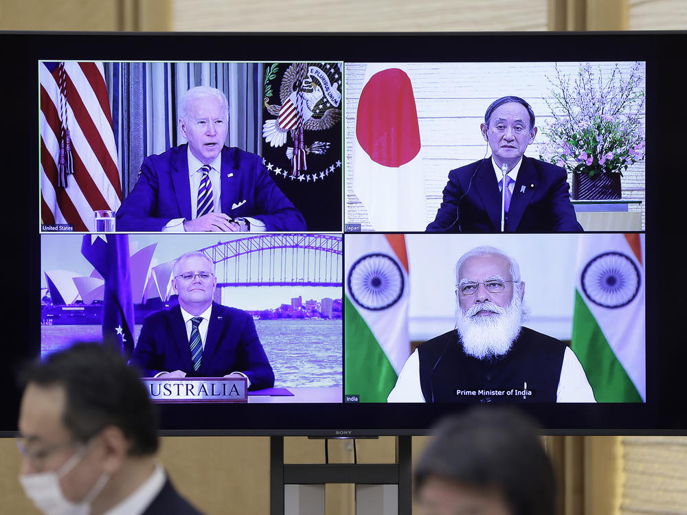 The last Quad meeting, in March, was virtual. President Biden, Yoshihide Suga, Japan's prime minister (top right), Scott Morrison, Australia's prime minister (bottom left), and Narendra Modi, India's prime minister, will meet in person in the U.S. on Friday.