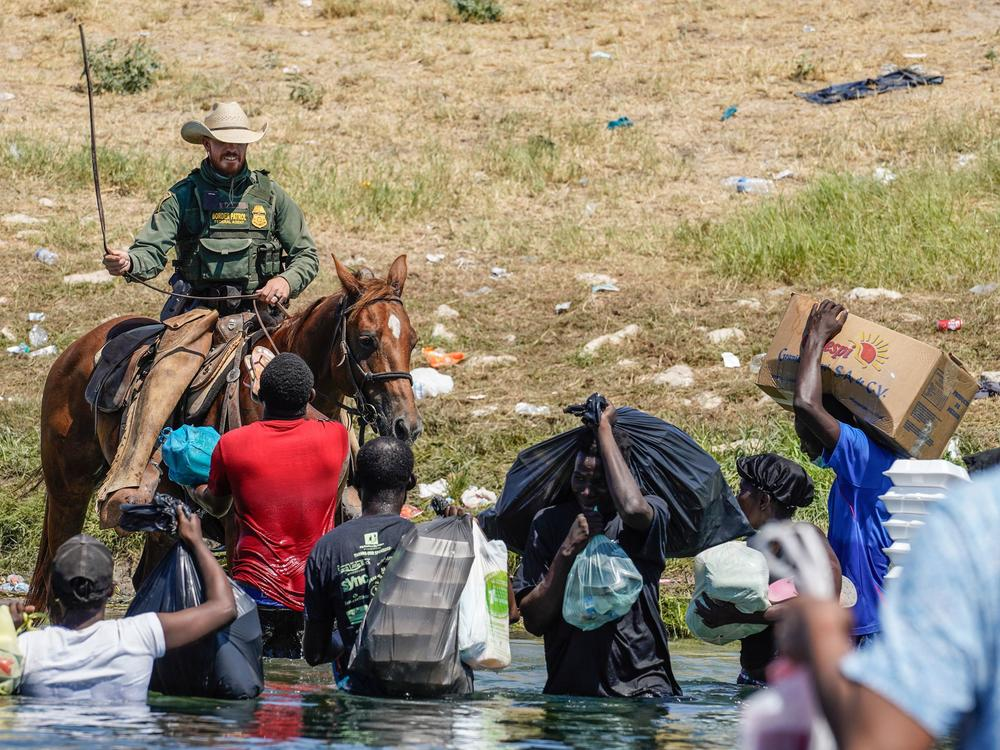 A United States Border Patrol agent on horseback uses the reins as he tries to stop Haitian migrants from entering an encampment on the banks of the Rio Grande near the Acuna Del Rio International Bridge in Del Rio, Texas on September 19, 2021.