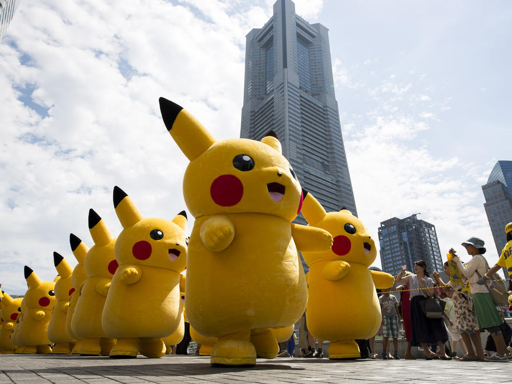 Performers dressed as Pikachu, a character from Pokemon series, march during the Pikachu Outbreak event hosted by The Pokemon Co. on August 9, 2017 in Yokohama, Kanagawa, Japan.