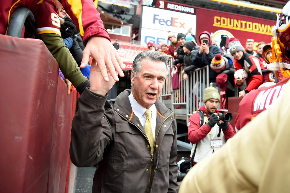 Bruce Allen, then president of the Washington Football Team, walks onto the field before a game against the New York Jets at FedExField in Maryland in 2019.