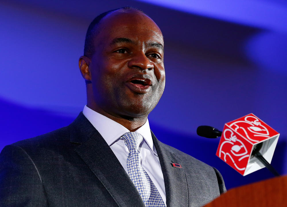 DeMaurice Smith, executive director of the NFL Players Association, speaks during a news conference in 2014.