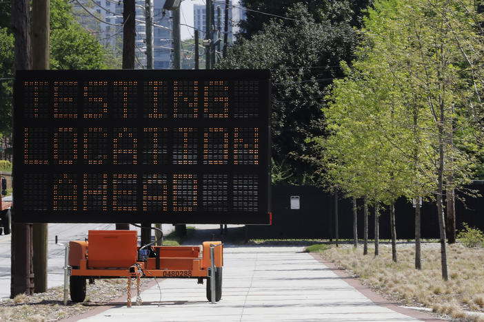 "A sign reading ""Testing Location Ahead"" is seen near the COVID-19 testing area on Georgia Tech's campus, Monday, April 6, 2020, in Atlanta."