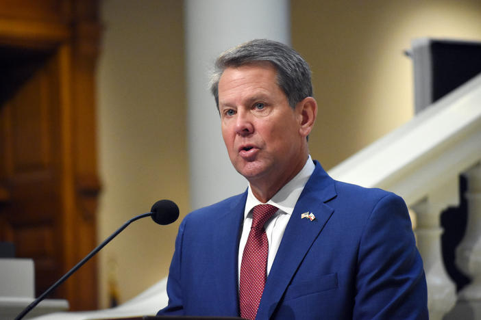 Gov. Brian Kemp speaks at a press conference.