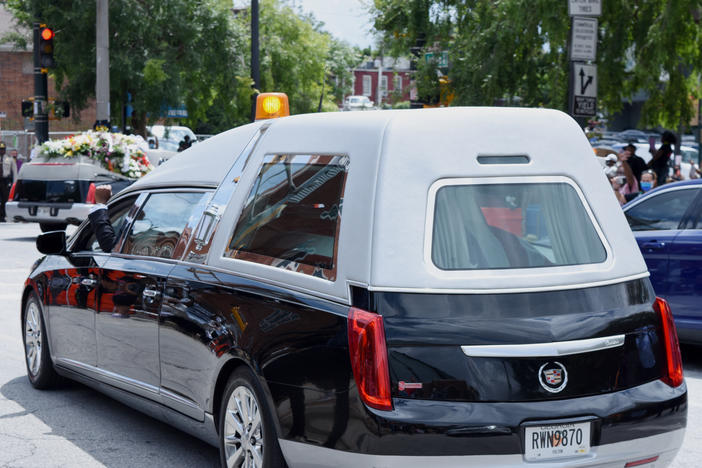 John Lewis' casket leaves Ebenezer Baptist Church en route to South-View Cemetery.