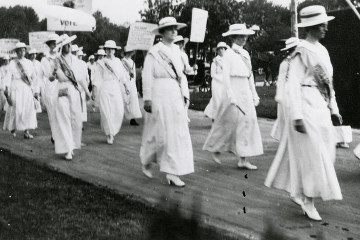 Mrs. Anne Dallas Dudley leads a march.