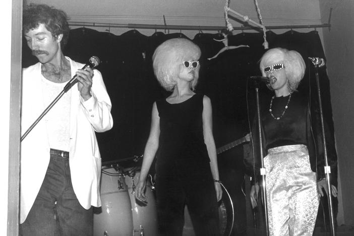 Fred Schneider, Cindy Wilson (middle), and Kate Pierson of the B-52's perform during the band's debut at an Athens, Georgia Valentine's Day party.