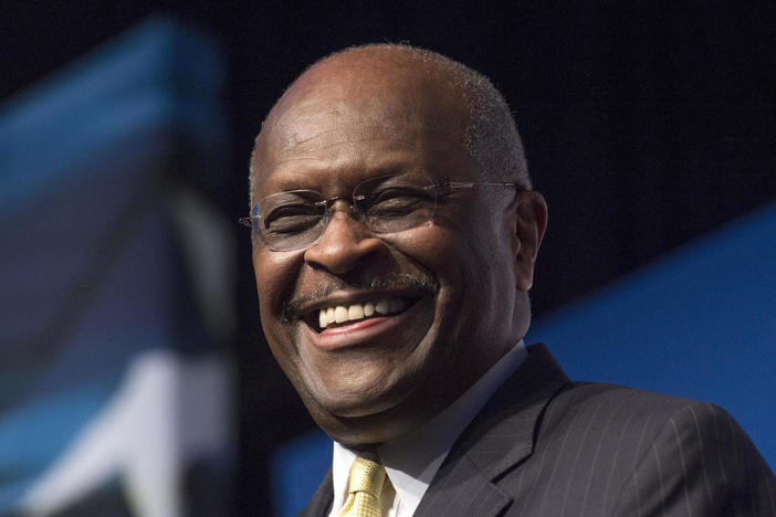In this June 20, 2014, file photo, Herman Cain, CEO, The New Voice, speaks during Faith and Freedom Coalition's Road to Majority event in Washington. Cain has died after battling the coronavirus.