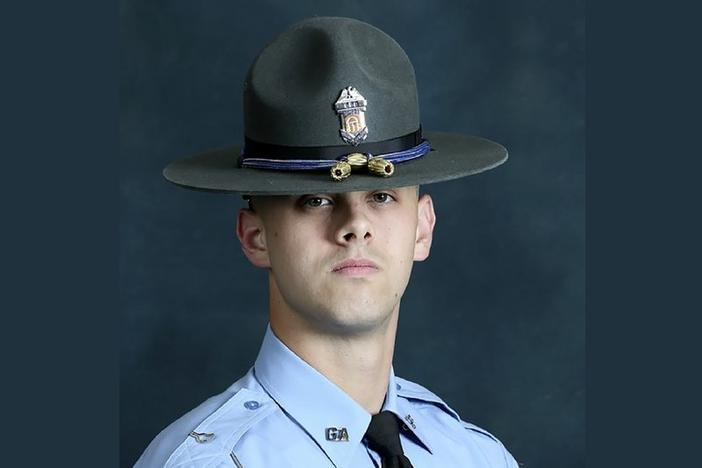 In this undated photo released by the Georgia Department of Public Safety, State trooper Jacob Gordon Thompson is seen in an official portrait. The Georgia Bureau of Investigation said in a statement Friday, Aug. 14, 2020 that Thompson was charged with felony murder and aggravated assault. The trooper has been fired and charged with murder a week after he fatally shot a 60-year-old man who attempted to flee a traffic stop.