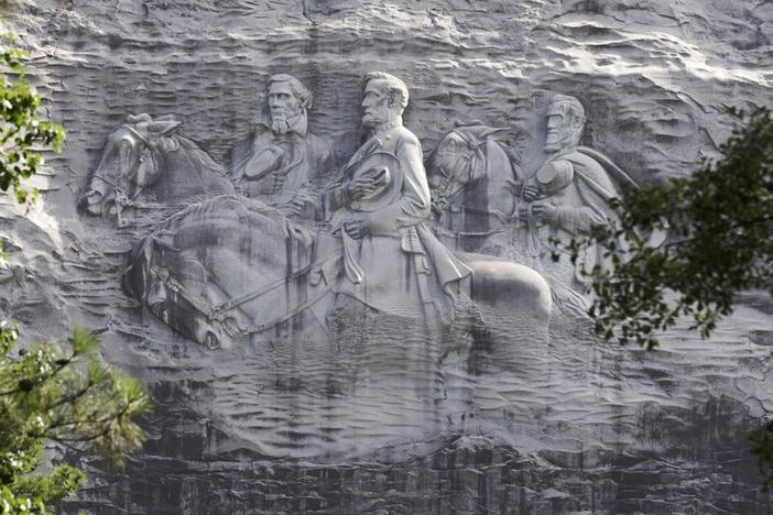This June 23, 2015 file photo shows a carving depicting Confederate Civil War figures Stonewall Jackson, Robert E. Lee and Jefferson Davis, in Stone Mountain, Ga. The sculpture is America's largest Confederate memorial.