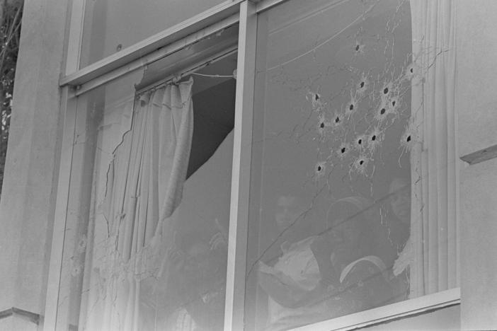 Students peer out of the bullet-riddled windows of Alexander Hall, a women's dormitory at Jackson State College in Jackson, Miss., after two African-American students were killed and 12 injured when police opened fire on the building, claiming they were fired upon by snipers, May 15, 1970. The shooting occurred after rioting broke out on the campus.