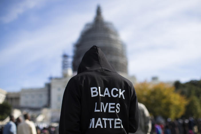 "Neal Blair, of Augusta, Ga., wears a hoodie which reads, ""Black Lives Matter"" as stands on the lawn of the Capitol building during a rally to mark the 20th anniversary of the Million Man March, on Capitol Hill, on Saturday, Oct. 10, 2015, in Washington."