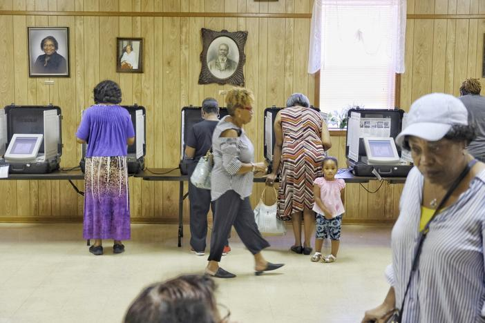 Voters inside of a polling location.