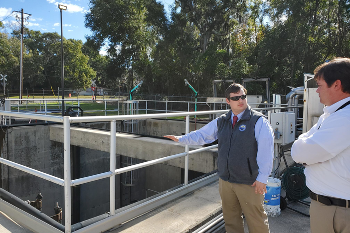 BGJWSC Executive Director Andrew Burroughs and Director of Engineering Todd Klein stand by the wet well at the Academy Creek Wastewater Treatment Plant. Its low walls mean water from a flood could infiltrate it.