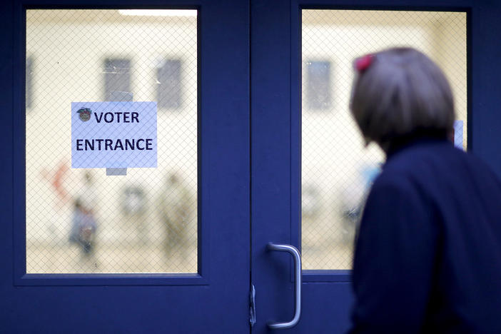 A voter enters a polling site in Atlanta, Tuesday, Nov. 7, 2017.