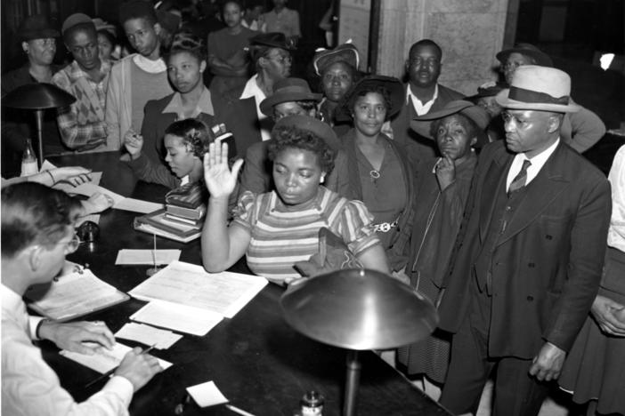 African Americans register to vote in the July 4 Georgia Democratic Primary in Atlanta, Ga., on May 3, 1944. Registrations are increasing in Atlanta as black schools are giving instructions to students in ballot casting procedure. (AP Photo)