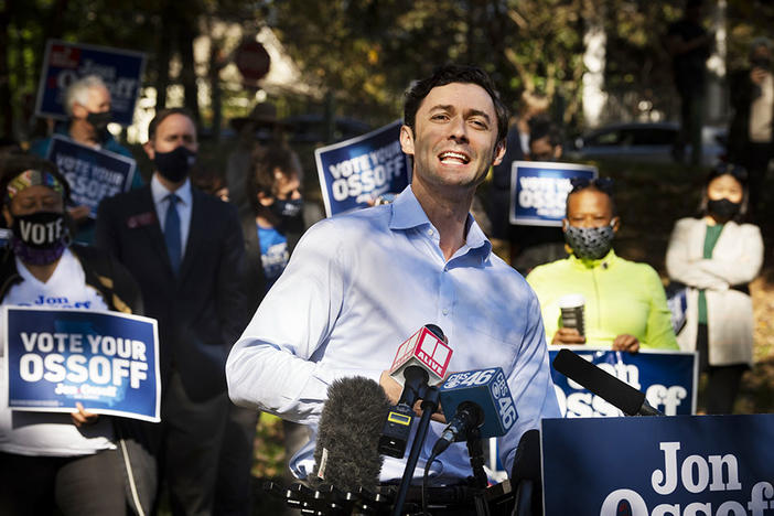Georgia Democratic candidate for U.S. Senate Jon Ossoff speaks to the media as he rallies supporters for a run-off against Republican candidate Sen. David Perdue, as they meet in Grant Park, Friday, Nov. 6, 2020, in Atlanta.