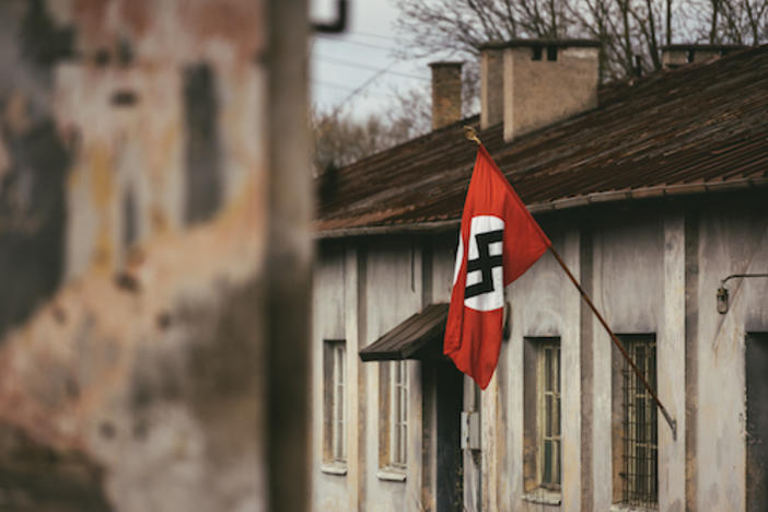 Drama Reconstruction Swastika Nazi flag in Dachau Concentration Camp
