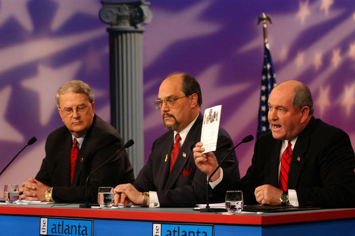 In 2002, then-Gov. Roy Barnes (GA-D), left, and Garrett Hayes, center, listen to Sonny Perdue, right, speak during a gubernatorial debate at GPB. Perdue would go on to defeat Barnes, becoming the first Republican to serve as Georgia's governor since Reconstruction.