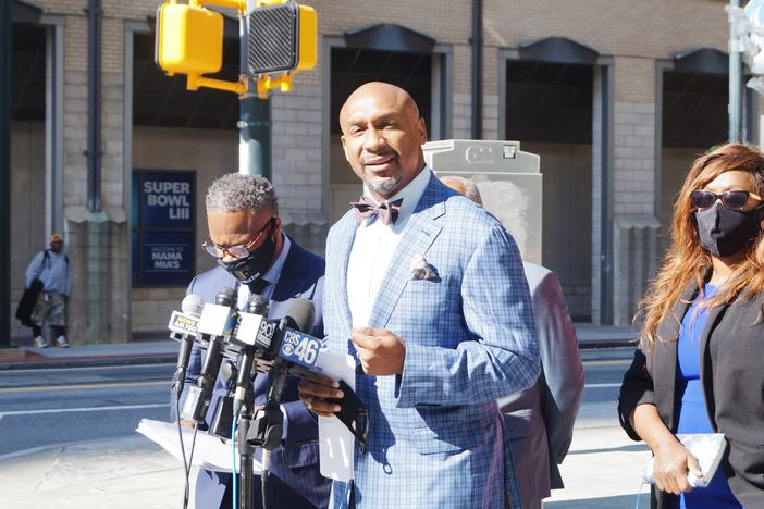 Secoriea Turner's family attorney Mawuli Davis addresses the media in October regarding the Bozeman Law Firm's intent to sue the city of Atlanta.