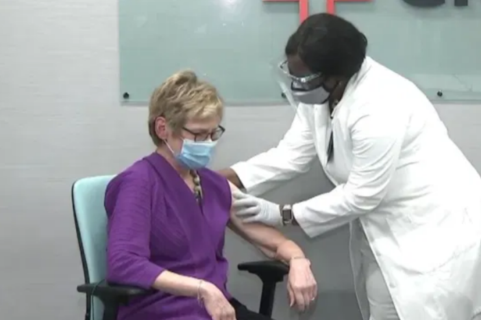 DPH Commissioner Dr. Kathleen Toomey receives a COVID-19 vaccine.
