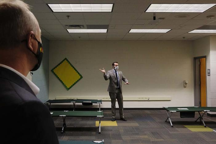 Macon-Bibb County Emergency Management Director Spencer Hawkins gives a tour of the new Brookdale Warming Center Monday.