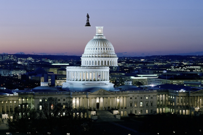 An image of the U.S. capitol at night with the image clipped and altered.