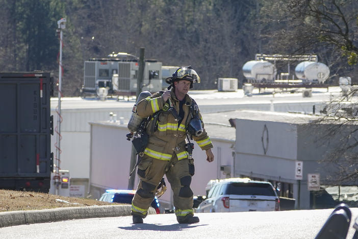 A Hall County firefighter leaves following a liquid nitrogen leak that killed six people at Prime Pak Foods, a poultry plant, on Thursday, Jan. 28, 2021, in Gainesville, Ga. (AP Photo/John Bazemore)